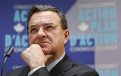 <p>Canada's Finance Minister Jim Flaherty listens to a journalist's question during a news conference, about Canada's Economic Action Plan, at the Auberge St-Antoine in Quebec City December 11, 2009. REUTERS/Mathieu Belanger</p>