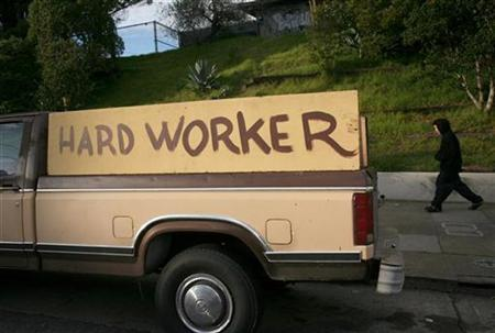 A handmade sign painted on the side of a pickup truck reading ''hard worker'' is shown in San Francisco, California, January 25, 2009. REUTERS/Robert Galbraith