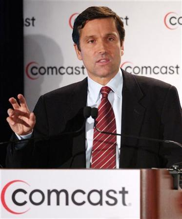 Stephen B. Burke, Executive Vice President and President, Comcast Cable, speaks at a press conference in New York on February 11, 2004. REUTERS/Chip East