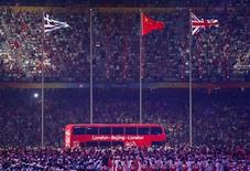 <p>A London bus takes part in the closing ceremony in the National Stadium at the Beijing 2008 Olympic Games August 24, 2008. REUTERS/Issei Kato</p>