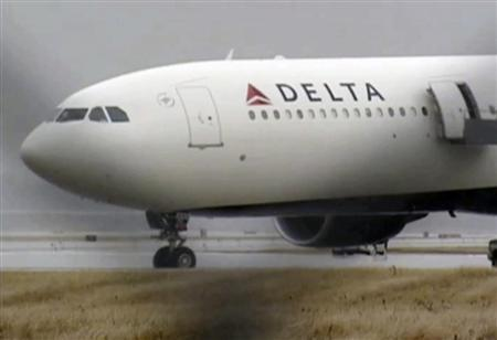 A Delta Airbus 330 airliner sits on a runway at Detroit Metropolitan Airport in Romulus, Michigan in this video grab made December 25, 2009. The system aimed at keeping air travel secure failed when a Nigerian man who was suspected of ties to militants managed to smuggle explosives aboard a flight, U.S. Homeland Security Secretary Janet Napolitano said on Monday. REUTERS/WDIV TV/Handout