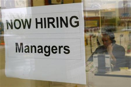 A hiring sign hangs in a window at PETCO in Falls Church, Virginia June 5, 2009. REUTERS/Kevin Lamarque