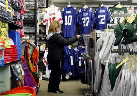 A woman shops at a sporting goods store in New York, December 18 , 2009. REUTERS/Shannon Stapleton