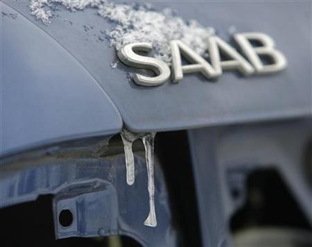Icicles hang from the trunk of a dismantled Saab vehicle in the courtyard of a service station in Budapest December 22, 2009. REUTERS/Karoly Arvai