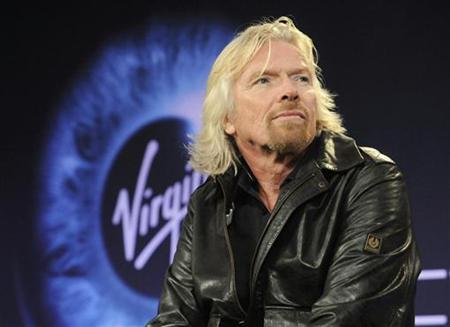 Billionaire Richard Branson participates in a news conference before Virgin Galactic's unveiling of its new commercial spaceship SpaceShipTwo in Mojave, California December 7, 2009 file photo. REUTERS/Phil McCarten