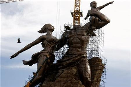 The nearly finished monument to the African Renaissance rises above the Dakar skyline in Senegal's capital August 19, 2009. REUTERS/Finbarr O'Reilly