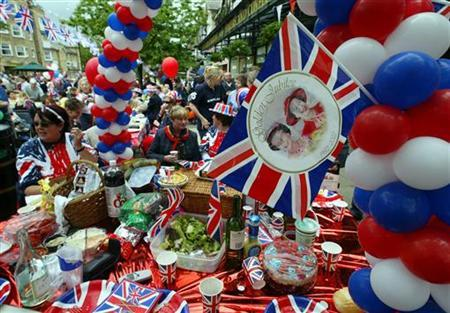 Residents of Ilkley, Yorkshire enjoy a Golden Jubilee street party in June 3, 2002. REUTERS/Ian Hodgson