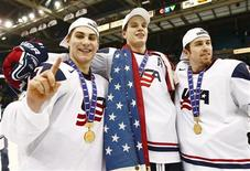 <p>Team USA's Ryan Bourque (L), John Carlson (C) and David Warsofsky are seen with their gold medals after they defeated Canada to win their gold medal game in overtime at the 2010 IIHF U20 World Junior Hockey Championship in Saskatoon, Saskatchewan January 5, 2010. REUTERS/Shaun Best</p>