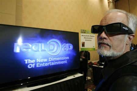 A guest wears 3D-glasses as he watches a Mitsubishi WD-82737 3D television during a media preview for the 2010 International Consumer Electronics Show (CES) in Las Vegas January 5, 2010. REUTERS/Mario Anzuoni