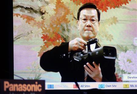 Fumio Ohtsubo, president of Panasonic Corp., appears in a live video feed from Japan with a 3D camcorder during a news conference at the 2010 International Consumer Electronics Show (CES) in Las Vegas, January 6, 2010. REUTERS/Steve Marcus