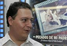 "<p>Sebastian Marroquin, son of Colombia's late drug lord Pablo Escobar, is photographed before the premiere of the documentary ""Sins of My Father"" in Bogota December 9, 2009. REUTERS/Fredy Builes</p>"