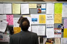 <p>A man looks at a job board at a job fair in Toronto in this April 1, 2009 file photo. Canada's labor market recovery stalled in December, unexpectedly losing 2,600 jobs after hefty gains in November, according to Statistics Canada data released on Friday. REUTERS/Mark Blinch</p>