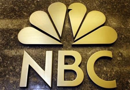 An NBC sign on the General Electric building in New York in this October 5, 2009 file photo. REUTERS/Mike Segar
