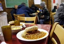 <p>A lunch meal portion waits at the Part of the Solution (POTS) soup kitchen and food pantry in the Bronx borough of New York, in this file image from December 13, 2006. REUTERS/Shannon Stapleton/Files</p>