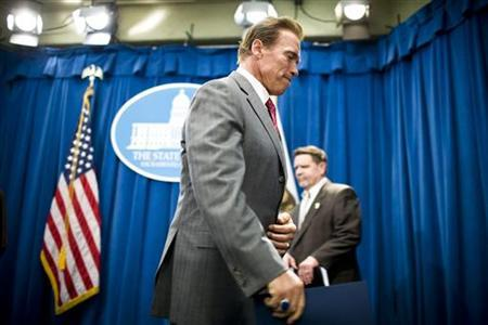 California Governor Arnold Schwarzenegger leaves a news conference at the State Capitol in Sacramento, July 1, 2009. REUTERS/Max Whittaker