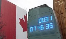 <p>The countdown clock for the 2010 Olympic Winter Games shows one month left before the start in Vancouver, British Columbia January 12, 2010. REUTERS/Andy Clark</p>
