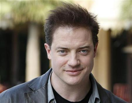 Actor Brendan Fraser smiles during a photocall at the 5th edition of the Dubai International Film Festival December 15, 2008. REUTERS/Jumana El Heloueh