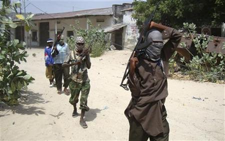Militants from the Hizbul Islam patrol the streets of Somalia's capital Mogadishu, January 11, 2010. REUTERS/Feisal Omar