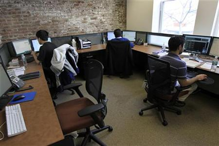 Employees work at the Tradeworx office in Red Bank, New Jersey November 17, 2009. REUTERS/Mike Segar