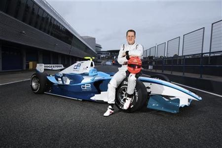 Formula One seven times world champion Michael Schumacher of Germany poses on a GP2 car during a test drive at Jerez circuit in southern Spain, January 12, 2010. REUTERS/Malcolm Griffitths/GP2 Media/Handout