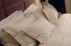 <p>A hotel employee gives a final touch to a pillow in a file photo. REUTERS/File</p>