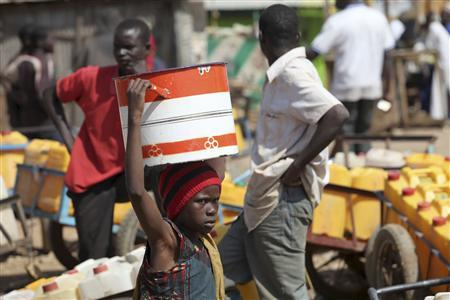 A girl fetches water from a local water point in Nigeria's central city of Jos January 21, 2010. Nigerian authorities relaxed a 24-hour curfew in the city of Jos on Thursday to allow thousands of residents to return to their homes following clashes between Muslims and Christians that killed hundreds. REUTERS/Akintunde Akinleye