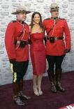 <p>Singer and songwriter Sarah McLachlan poses with members of the Royal Canadian Mounted Police on the red carpet during the Juno Awards in Vancouver, British Columbia March 29, 2009. REUTERS/Richard Lam</p>