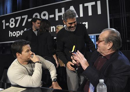 Actors Mark Wahlberg (L), George Clooney (C) and Jack Nicholson take part in the ''Hope for Haiti Now: A Global Benefit for Earthquake Relief'' telethon in Los Angeles, California January 22, 2010. REUTERS/Marc Davis/MTV Hope for Haiti Now/Handout