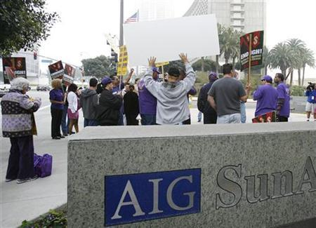 Protesters gather outside the AIG building in Los Angeles in this March 19, 2009 file photo. A U.S. bailout watchdog has launched two new investigations into the New York Federal Reserve Bank's actions on insurer AIG's <AIG.N> disclosure of payments to banks after its 2008 rescue, excerpts of prepared congressional testimony showed on Monday. REUTERS/Mario Anzuoni