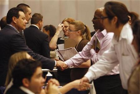 People talk to job recruiters at a career fair in Los Angeles, February 3, 2009. REUTERS/Lucy Nicholson