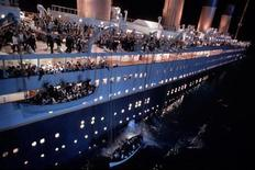 "<p>Lifeboats are lowered to the ocean in a scene from the 1997 James Cameron film ""Titanic"". REUTERS/File</p>"