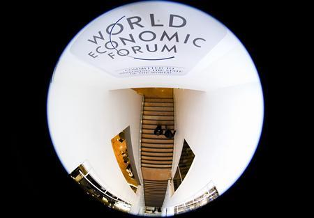 People enter the congress centre of the Alpine resort of Davos, the venue of the World Economic Forum (WEF), January 26, 2010. REUTERS/Michael Buholzer
