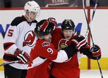 <p>Ottawa Senators Jason Spezza (R) celebrates his goal against the New Jersey Devils with teammate Shean Donovan (C) during the first period of their NHL game in Ottawa January 26, 2010. Also pictured is Devils Colin White (L). REUTERS/Chris Wattie</p>