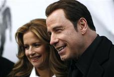 "<p>Actor John Travolta (R) and his wife Kelly Preston speak to television reporters as they arrive at the premiere of ""From Paris With Love"" in New York January 28, 2010. REUTERS/Jessica Rinaldi</p>"