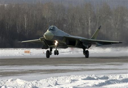 A new Russian T-50 fighter lands at an airfield of the Sukhoi aircraft manufacturing plant in Komsomolsk-on-Amur, January 23, 2010. REUTERS/Sukhoi Press Service/Handout