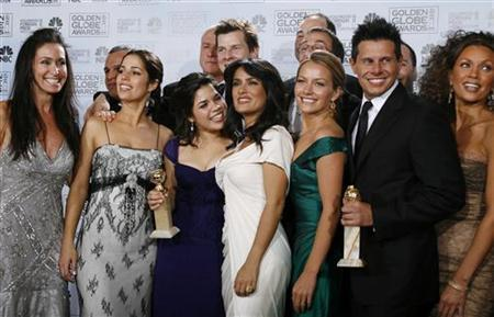 Cast members from ''Ugly Betty'' pose together backstage during the 64th annual Golden Globe Awards in 2007. REUTERS/Mike Blake