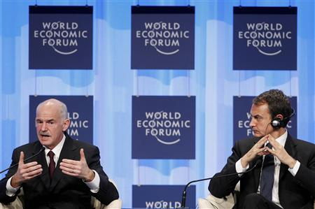 Greece's Prime Minister George Papandreou (L) speaks next to Spain's Prime Minister Jose Luis Rodriguez Zapatero during a session at the World Economic Forum (WEF) in Davos January 28, 2010. REUTERS/Christian Hartmann