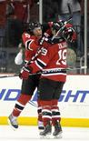 <p>New Jersey Devils left wing Zach Parise leaps into the arms of center Travis Zajac (19) after Zajac scored the winning goal against the Toronto Maple Leafs in the overtime period of their NHL game in Newark, New Jersey January 29, 2010. REUTERS/Ray Stubblebine</p>