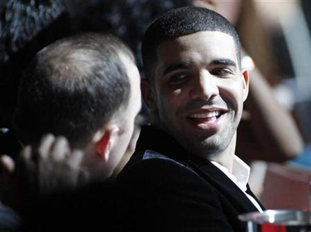 Recording artist Drake reacts at his table after it was announced that he was a Best Rap Solo Performance nominee during The Grammy Nominations Concert Live - Countdown to the Music's Biggest Night event in Los Angeles, California, December 2, 2009. REUTERS/Danny Moloshok