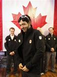 <p>Brian McKeever puts on his Team Canada Olympic jacket after he was announced to the Olympic Cross Country ski team in Canmore January 22, 2010. McKeever, who is legally blind, will make history this February by competing in both the regular 2010 Winter Olympic games and the Paralympic Winter Games. REUTERS/Todd Korol</p>