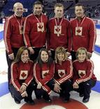 <p>The men's and women's Team Canada pose for a photo the Canadian Olympic curling trials final in Edmonton, Alberta December 13, 2009. The men's team (back row) includes Skip Kevin Martin, third John Morris (2nd L) second Marc Kennedy and lead Ben Hebert (R). The women's team (bottom row) includes Skip Cheryl Bernard, third Susan O'Connor (2nd L), second Carolyn Darbyshire and lead Cori Bartel (R) REUTERS/Dan Reidlhuber</p>
