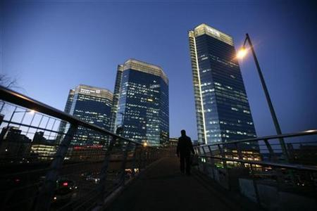 A man walks on an overpass on Jianguo Road near office buildings in Beijing's central business district in this January 6, 2009 file photo. REUTERS/Jason Lee