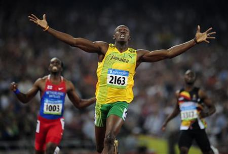 Usain Bolt of Jamaica celebrates winning the men's 200m final of the athletics competition in the National Stadium at the Beijing 2008 Olympic Games in this August 20, 2008 file photo. REUTERS/Dylan Martinez