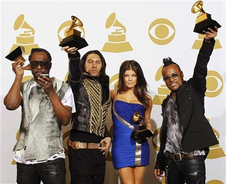 Black Eyed Peas' (from L to R) will.i.am, Taboo, Fergie and apl.de.ap pose with their Grammy awards at the 52nd annual Grammy Awards in Los Angeles January 31, 2010. REUTERS/Lucy Nicholson
