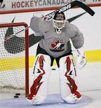 <p>Martin Brodeur of the New Jersey Devils tries to make a save during the White team's practice at Team Canada's Olympic hockey training camp in Calgary, August 25, 2009 file photo. REUTERS/Todd Korol</p>