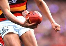 <p>The Adelaide Crows' Andrew McLeod in action during the Australian Football League (AFL) grand final against St. Kilda at the Melbourne Cricket Ground September 27, 1997. REUTERS/Darrin Braybrook</p>