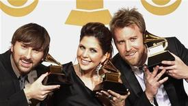 <p>Members of Lady Antebellum, Charles Kelley (R), Hillary Scott, (C) and Dave Haywood, hold their award at the 52nd annual Grammy Awards in Los Angeles January 31, 2010. REUTERS/Lucy Nicholson</p>