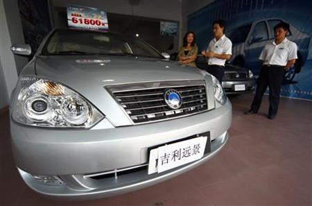 A customer talks to a salesmen near a Geely Vision car at a Geely Automotive showroom in Suining, Sichuan province September 16, 2009. REUTERS/Stringer