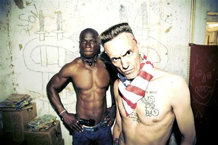 Ninja (R), front man for the Afrikaans rap group Die Antwoord (The Answer), poses with an unidentified man. REUTERS/Handout
