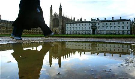 A student walks along at the rear of Kings' College in Cambridge, southern England, January 8, 2004. REUTERS/Russell Boyce